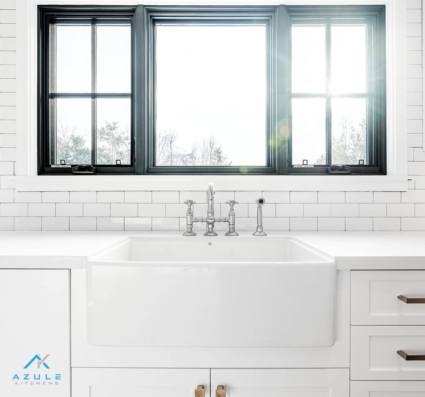 white farmhouse sink with farmhouse faucet on a white shaker kitchen at azule kitchens for sale